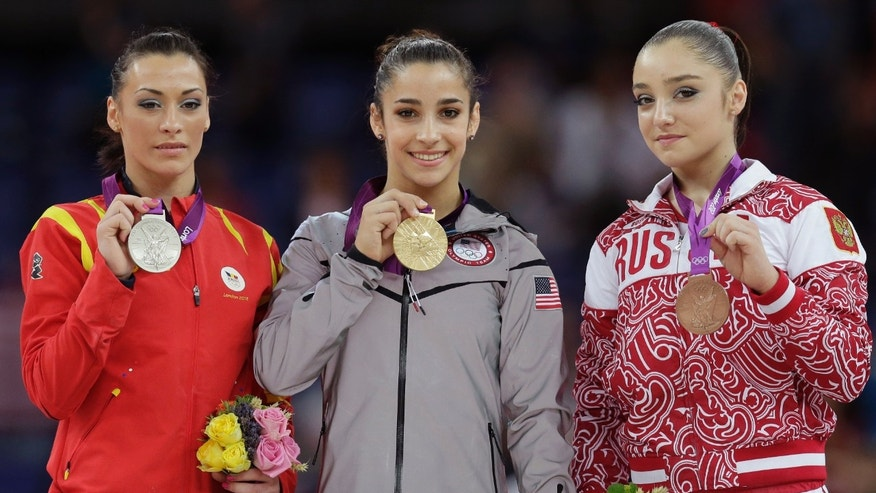 Aug. 7, 2012: U.S. gold medallist gymnast Alexandra Raisman, center, Romania's silver medallist Catalina Ponor, left, and bronze medallist Russia's Aliya Mustafina display their medals during the podium ceremony for the artistic gymnastics women's floor exercise final at the 2012 Summer Olympics.