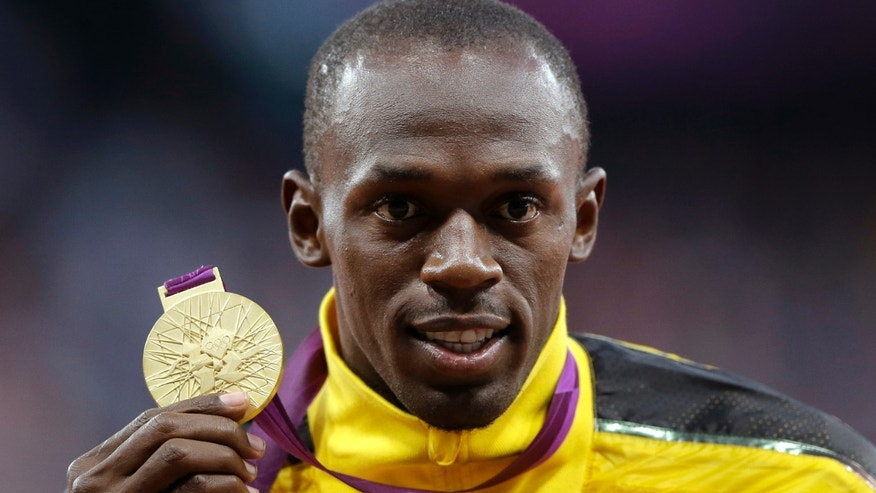 Aug. 6, 2012: Jamaica's Usain Bolt poses with his gold medal for the men's 100-meters during the athletics in the Olympic Stadium at the 2012 Summer Olympics, London.