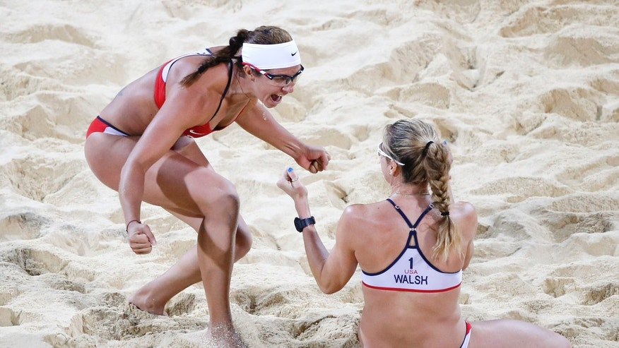 Aug. 8, 2012: United States Kerri Walsh Jennings, right, and Misty May-Treanor celebrate after defeating April Ross and Jennifer Kessy in a women's gold medal beach volleyball match at the 2012 Summer Olympics, London, Wednesday.