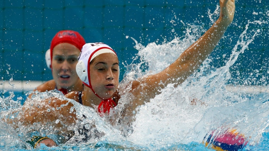 Aug. 7, 2012: Maggie Steffens, top, of the United States defends against Holly Lincoln-Smith of Australia during a women's semifinal water polo match at the 2012 Summer Olympics, in London.