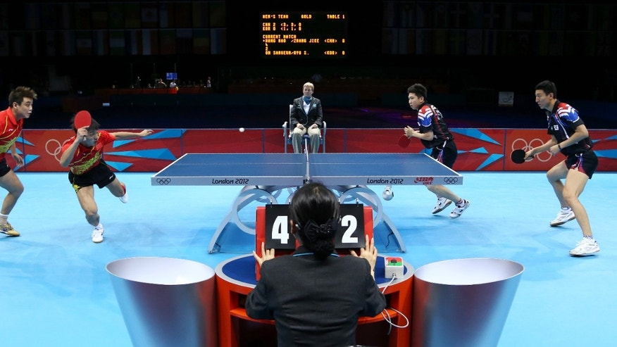 Aug. 8, 2012: Wang Hao and Zhang Jike of China, right, compete against Oh Sangeun and Ryu Seungmin of South Korea in the men's team table tennis gold  medal match at the 2012 Summer Olympics in London.