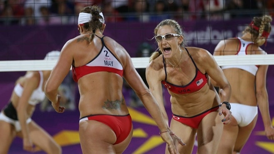 Aug. 8, 2012: United States' Kerri Walsh Jennings, right, and Misty May-Treanor, left, react during the women's gold medal beach volleyball match against the other US team at the 2012 Summer Olympics in London.