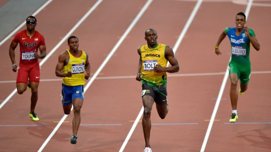 Jamaica's Usain Bolt crosses the finish line ahead of United States' Isiah Young, left, Ecuador's Alex Quinonez and Brazil's Aldemir Da Silva Junior, right, in the men's 200-meter semifinal during the athletics in the Olympic Stadium at the 2012 Summer Olympics, London, Wednesday, Aug. 8, 2012. (AP Photo/Martin Meissner)