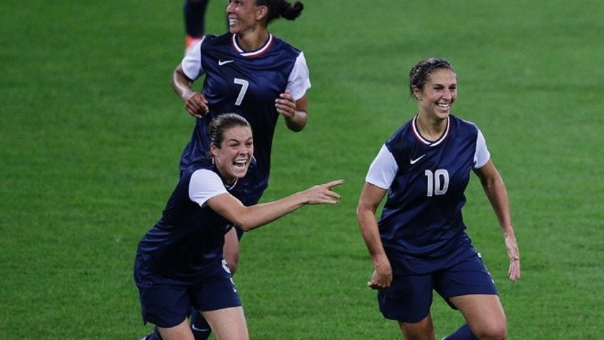 Aug. 9, 2012: United States' Carli Lloyd (10) celebrates with teammates after scoring her second goal during the women's soccer gold medal match against Japan.