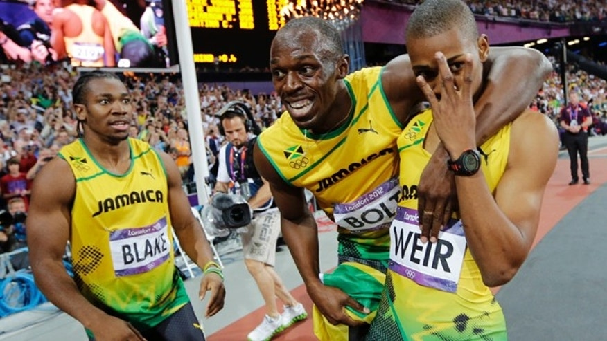 Aug. 9, 2012: Jamaica's Usain Bolt, center, celebrates with teammates Yohan Blake, left, and Warren Weir after they swept the men's 200-meter final at the London Olympics.