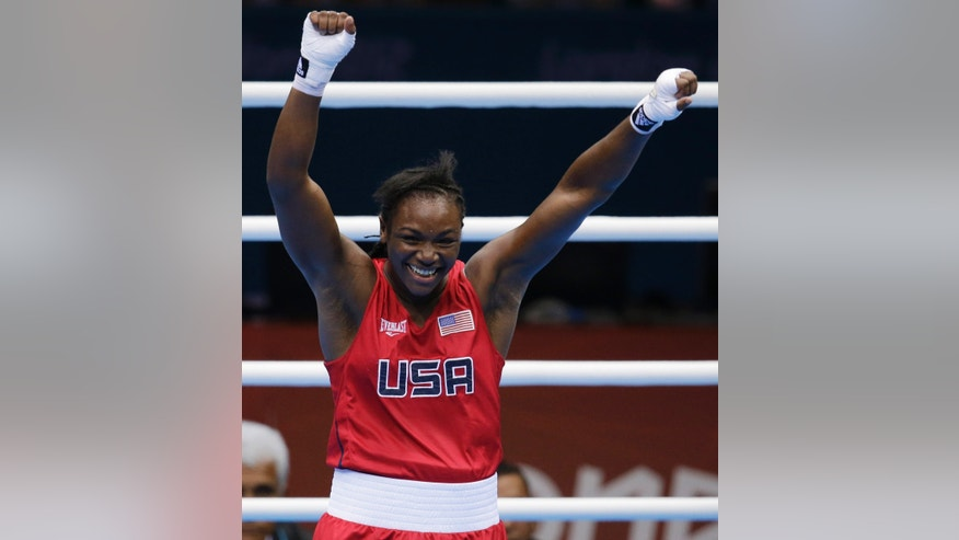The United States&#39&#x3b; Claressa Shields, celebrates after winning her fight against Russia&#39&#x3b;s Nadezda Torlopova, during the women&#39&#x3b;s middleweight 75-kg boxing gold medal match at the 2012 Summer Olympics, Thursday, Aug. 9, 2012, in London. (AP Photo/Patrick Semansky)
