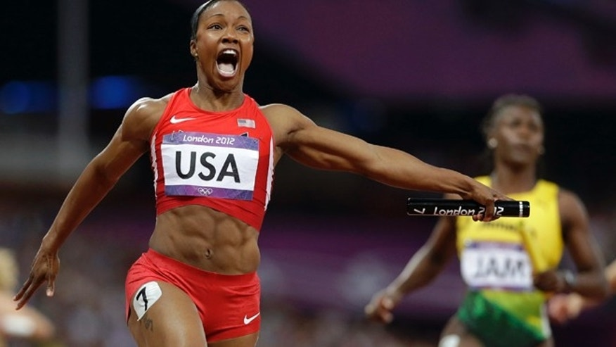 Aug. 10, 2012: United States' Carmelita Jeter reacts as she crosses the finish line to win the women's 4x100-meter relay at the London Olympics.
