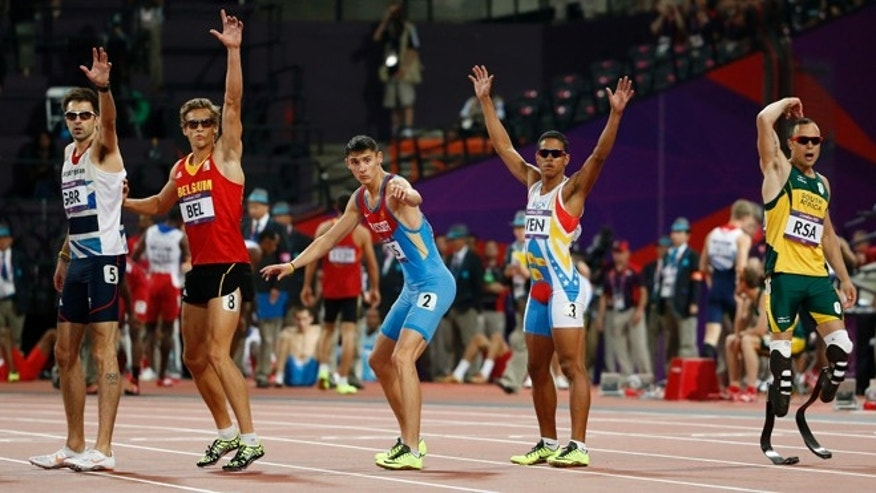 Aug. 10, 2012: From left, Britain's Martyn Rooney, Belgium's Michael Bultheel, Russia's Pavel Trenikhin, Venezuela's Omart Longart and South Africa's Oscar Pistorius wait for the batons during the men's 4x400-meter relay final.