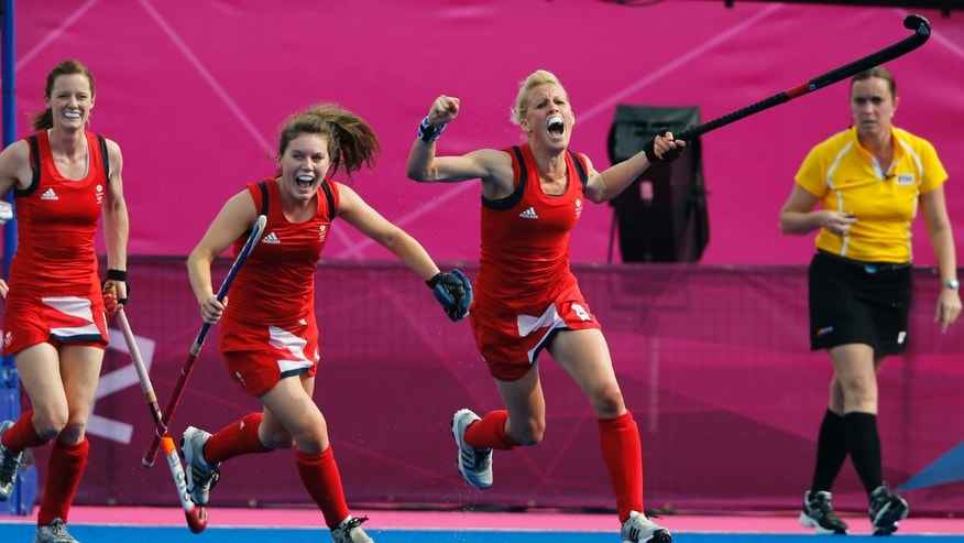 Britain&#39&#x3b;s Alex Danson, right, celebrates after scoring a goal against New Zealand during the women&#39&#x3b;s field hockey bronze medal match at the 2012 Summer Olympics, Friday, Aug. 10, 2012, in London. (AP Photo/Eranga Jayawardena)