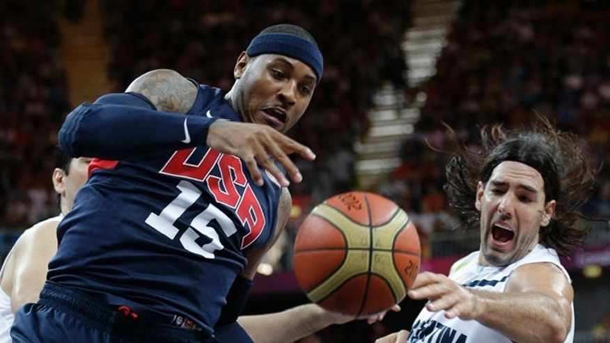 Aug. 6, 2012: USA's Carmelo Anthony (15) and Argentina's Luis Scola, right, scramble for the ballduring a preliminary men's basketball game.