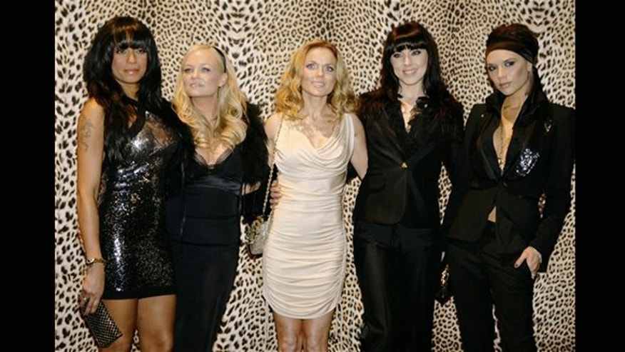 FILE - Jan. 14, 2008: The Spice Girls, from left, Melanie Brown, Emma Bunton, Geri Halliwell  Melanie Chishlom and Victoria Beckham pose backstage prior to the start of the Roberto Cavalli Fall/Winter 2008/2009 men's collection fashion show, in Milan, Italy.