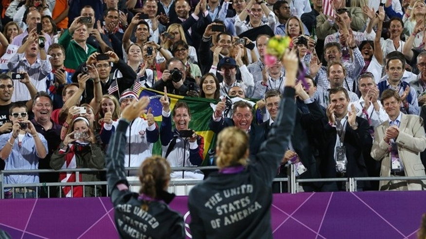 Aug. 8, 2012: Americans Missy May Treanor and Kerri Walsh Jennings acknowledge the crowd with their gold medals in beach volleyball.