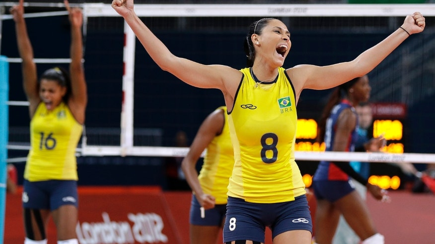 Aug. 11, 2012: Brazil's Jaqueline Carvalho (8) and Fernanda Rodrigues (16) react after a point against the USA during the women's volleyball final at the London Olympics.