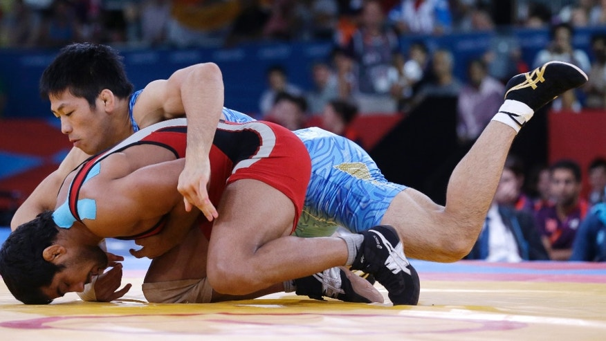 Aug. 12, 2012: Sushil Kumar of India competes with Tatsuhiro Yonemitsu of Japan (in blue) during their 66-kg freestyle wrestling gold medal match at the 2012 Summer Olympics, Sunday, in London.