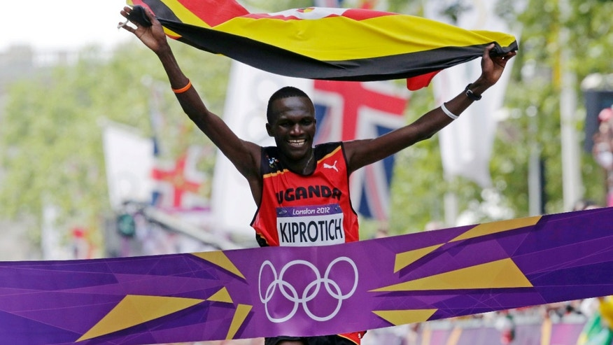 Wilson Kipsang Kiprotich of Uganda crosses the finish line to win the men's marathon at the 2012 Summer Olympics in London, Sunday, Aug. 12, 2012. (AP Photo/Luca Bruno)