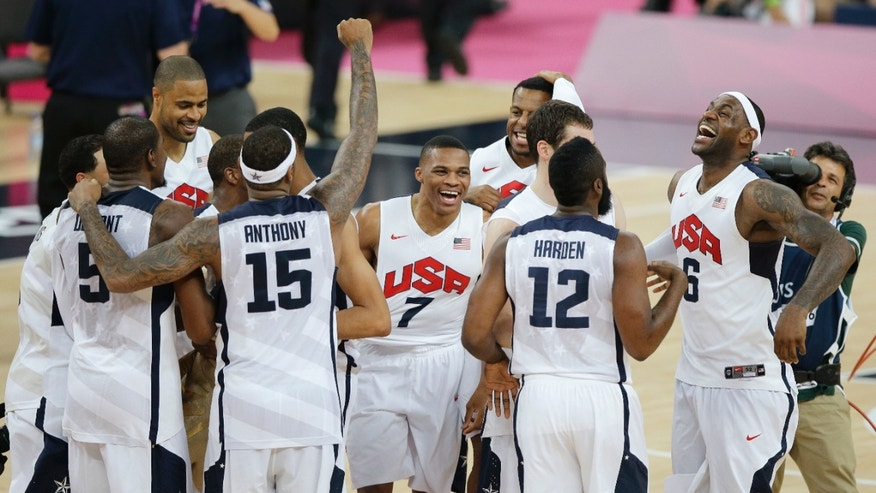 Aug. 12, 2012: Members of the United States basketball team celebrate after defeating Spain in the men's gold medal basketball game at the 2012 Summer Olympics in London.