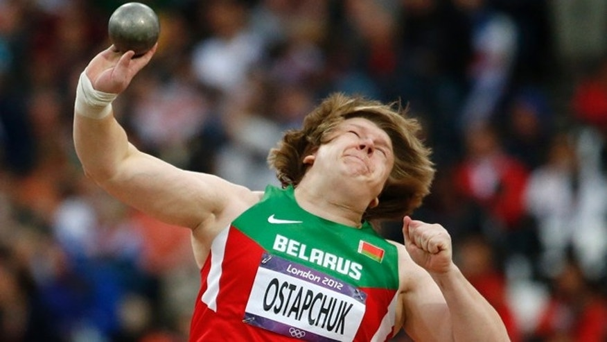 Aug. 6, 2012: In this file photo, Belarus' Nadzeya Ostapchuk takes a throw in the women's shot put final during the athletics in the Olympic Stadium at the 2012 Summer Olympics, London. Ostapchuk became the first athlete to be stripped of a medal at the London Olympics after her gold was withdrawn for doping. Valerie Adams of New Zealand will now take gold and Evgeniia Kolodko of Russia will get silver. Fourth-place finisher Gong Lijiao of China moves up to bronze.