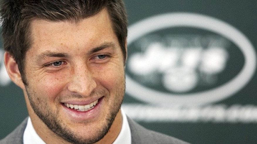 March 26, 2012: Tim Tebow holds his first news conference with the New York Jets in Florham Park, N.J. Tebow, who led the Denver Broncos to the playoffs last year, will serve as the backup quarterback to Mark Sanchez. (AP)