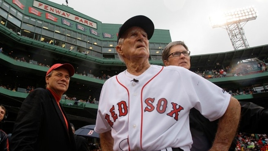Sept. 28, 2008: Boston Red Sox great Johnny Pesky, center, is flanked by team president Larry Lucchino, left, and owner John Henry as they look past Pesky&#39&#x3b;s Pole where Pesky&#39&#x3b;s No. 6 adorns the upper deck during a ceremony to retire his number.