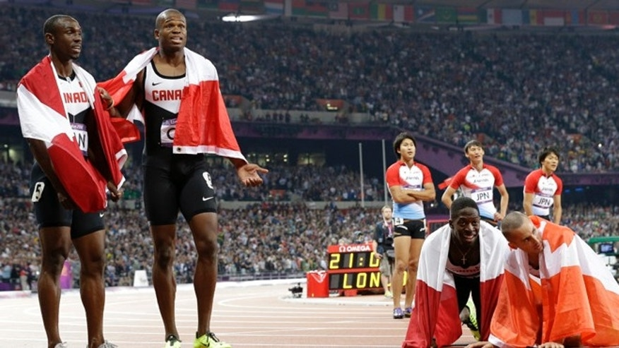 Aug. 11, 2012: The men's relay teams from Canada and Japan react after competing in the men's 4 x 100-meter relay during the athletics in the Olympic Stadium at the 2012 Summer Olympics, London.