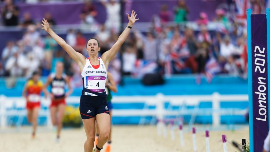 Aug. 12, 2012: Samantha Murray, of Great Britain, celebrates as she crosses the finish line to win the silver medal of the women's modern pentathlon, at the 2012 Summer Olympics, in London