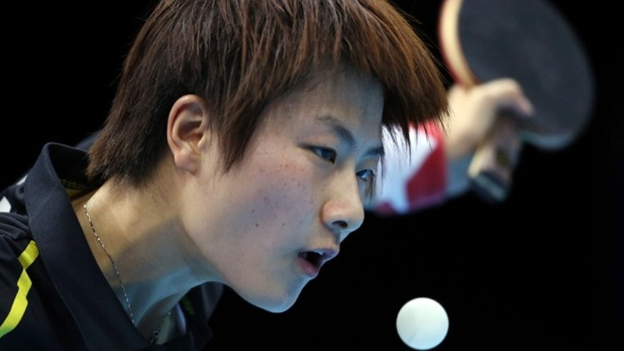 July 31, 2012: Ding Ning of China competes against Ai Fukuhara of Japan during the women's singles table tennis competition at the 2012 Summer Olympics, in London.