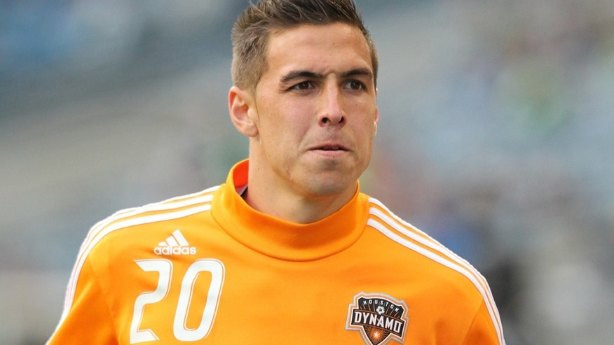 SEATTLE, WA - MARCH 25:  Geoff Cameron #20 of the Houston Dynamo warms up prior to the game against the Seattle Sounders FC at Qwest Field on March 25, 2011 in Seattle, Washington. (Photo by Otto Greule Jr/Getty Images)