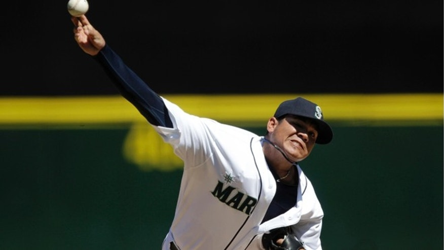 Aug. 15, 2012: Seattle Mariners starting pitcher Felix Hernandez throws to a Tampa Bay Rays batter in the fourth inning of a baseball game in Seattle.