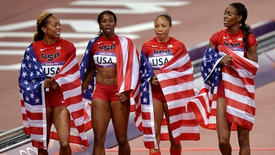 Aug. 11, 2012: United States' women's relay team members from left, Sanya Richards-Ross, Francena McCorory, Allyson Felix, and Deedee Trotter wear their national flag after their gold medal win in the 4 x 400-meter relay during the athletics in the Olympic Stadium at the 2012 Summer Olympics, London.