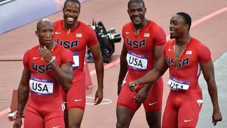 Aug. 10, 2012: The United States' men's 4 x100-meter relay team from left, Trell Kimmons, Darvis Patton, Justin Gatlin and Jeffrey Demps react after finishing first in their heat during the athletics in the Olympic Stadium at the 2012 Summer Olympics, London.