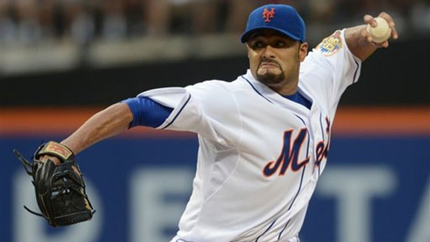 New York Mets' Johan Santana pitches for the first time since July 20 in the first inning of the baseball game against the Atlanta Braves at Citi Field in New York, Saturday, Aug. 11 2012. (AP Photos/Henny Ray Abrams)