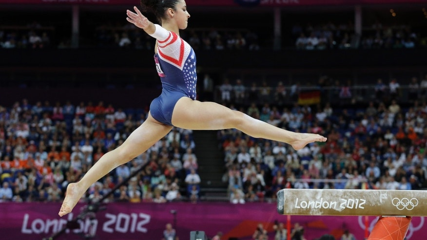 Aug. 7, 2012: U.S. gymnast Alexandra Raisman jumps on the beam to start her exercise during the artistic gymnastics women's apparatus finals at the 2012 Summer Olympics in London.