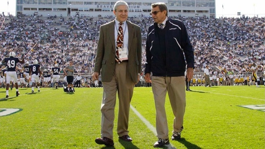 Oct. 8, 2011: This file photo Penn State president Graham Spanier, left, and head football coach Joe Paterno chat before an NCAA college football game against Iowa in State College, Pa.