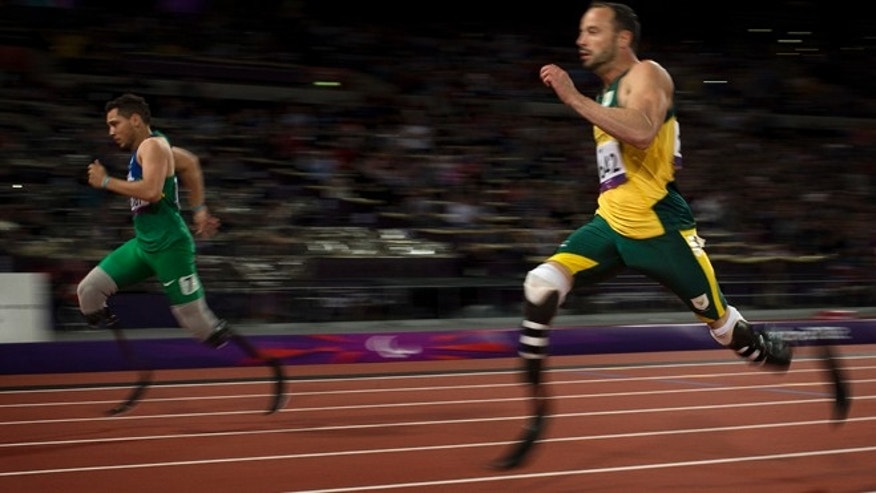 Sept. 2, 2012: Brazil's Alan Fonteles Cardoso Oliveira, left, beats South Africa's Oscar Pistorius in the 200-meter sprint at the 2012 Paralympics.