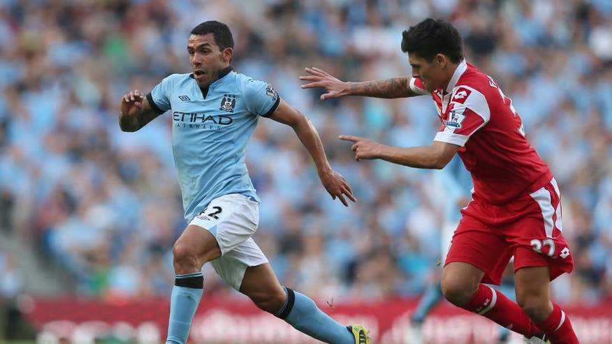 MANCHESTER, ENGLAND - SEPTEMBER 01:  Carlos Tevez of Manchester City moves away from Alejandro Faurlin of Queens Park Rangers during the Barclays Premier League match between Manchester City and Queens Park Rangers  at Etihad Stadium on September 1, 2012 in Manchester, England.  (Photo by Clive Brunskill/Getty Images)