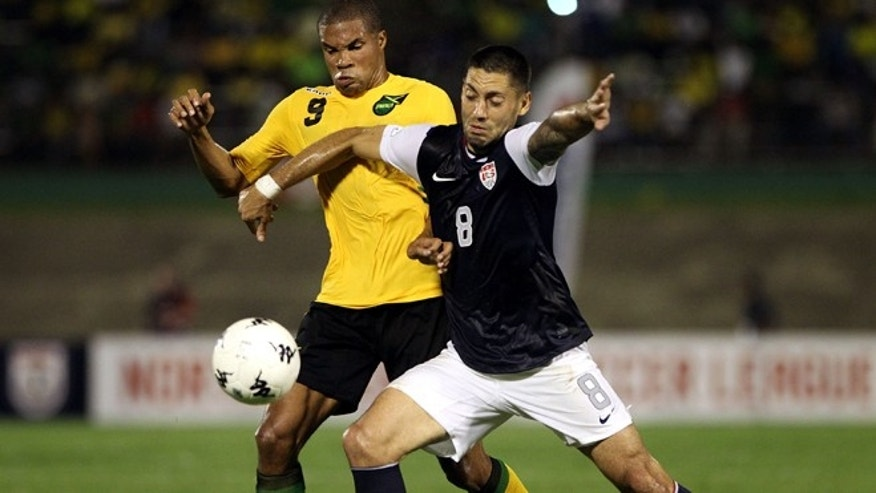 KINGSTON, JAMAICA - SEPTEMBER 07:  Clint Dempsey #8 of the United States battles for the ball with Ryan Johnson #9 of Jamaica during the United States and Jamaica World Cup Qualifier at National Stadium on September 7, 2012 in Kingston, Jamaica.  (Photo by Marc Serota/Getty Images)