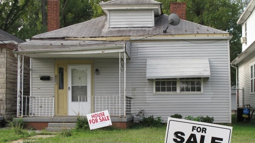 Aug. 27, 2012: A for sale signs in the front yard of Muhammad Ali's boyhood home in Louisville, Ky. A fan of the boxing legend has acquired the important piece of memorabilia; Louisville Realtor Dave Lambrechts said Las Vegas real estate investor Jared Weiss closed on the property Sept. 10, 2012, paying $70,000. Lambrechts says the new owner wants to restore the home to how it looked when Ali, then known as Cassius Clay, lived in it. (AP)