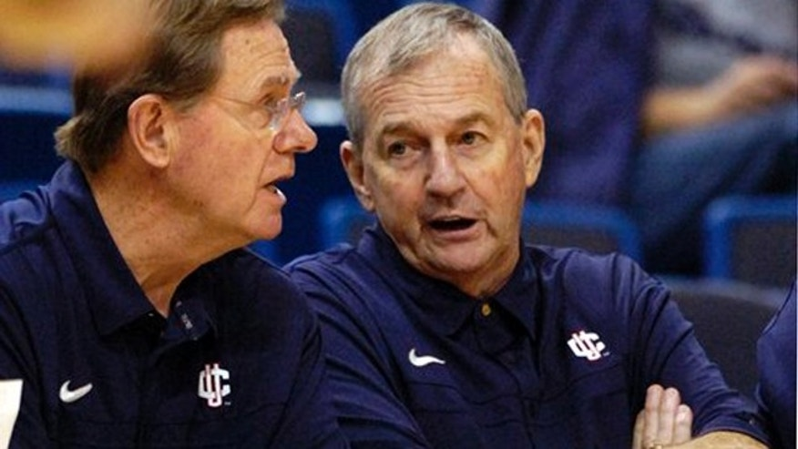 Nov. 7, 2010: Connecticut coach Jim Calhoun, right, speaks with associate head coach George Blaney during the second half of Connecticut's 103-57 victory over Bridgeport in an exhibition NCAA college basketball game in Hartford, Conn. Calhoun announced his retirement Thursday. (AP)