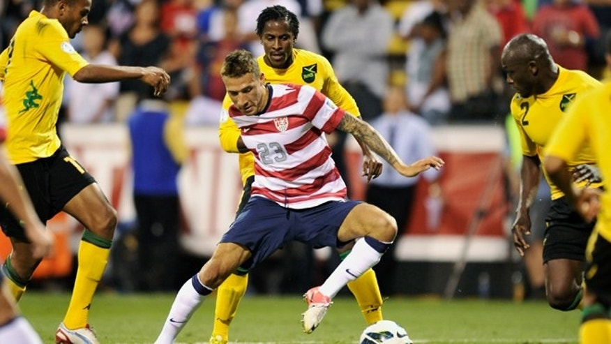 COLUMBUS, OH - SEPTEMBER 11:  Fabian Johnson #23 of the U.S. National Team maintains control of the ball as he maneuvers through a trio of Jamaican defenders on September 11, 2012 at Crew Stadium in Columbus, Ohio. USA defeated Jamaica 1-0.  (Photo by Jamie Sabau/Getty Images)
