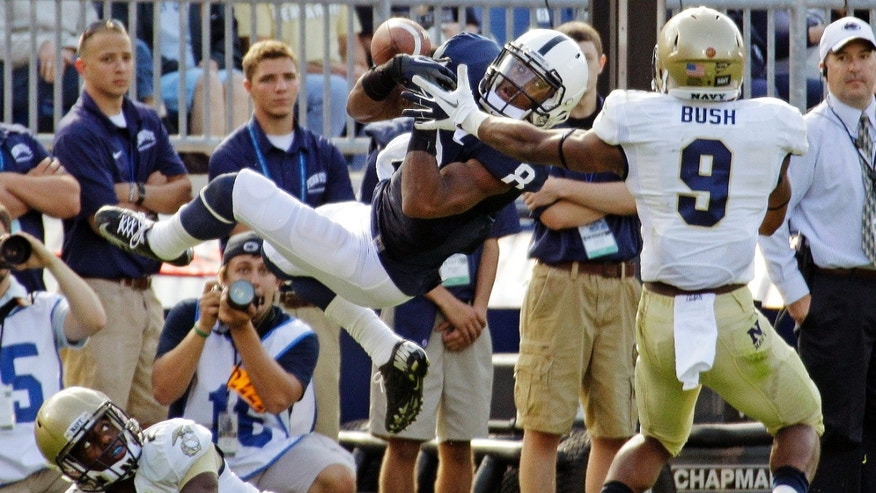 Sept. 15, 2012: Penn State wide receiver Allen Robinson (8) cannot hang on to a pass after colliding with Navy cornerback Parrish Gaines (2) and safety Tra'ves Bush (9) during the second quarter of an NCAA college football game in State College, Pa.