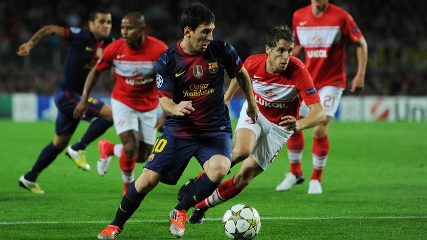 BARCELONA, SPAIN - SEPTEMBER 19: Lionel Messi of Barcelona controls the ball during the UEFA Champions League group G match between FC Barcelona and FC Spartak Moscow at the Camp Nou stadium on September 19, 2012 in Barcelona, Spain.  (Photo by Jasper Juinen/Getty Images)