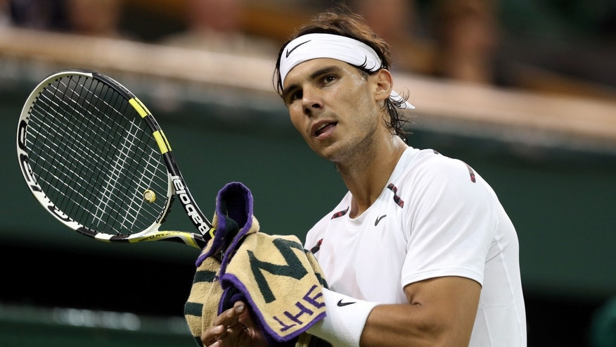 LONDON, ENGLAND - JUNE 28:  Rafael Nadal of Spain reacts during his Gentlemen's Singles second round match against Lukas Rosol of the Czech Republic on day four of the Wimbledon Lawn Tennis Championships at the All England Lawn Tennis and Croquet Club on June 28, 2012 in London, England.  (Photo by Clive Rose/Getty Images)