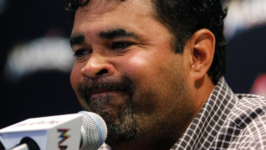Miami Marlins manager Ozzie Guillen gestures during at a news conference at Marlins Stadium in Miami, Tuesday April 10, 2012. Guillen has been suspended for five games because of his comments about Fidel Castro. He has again apologized and says he accepts the punishment.  (AP Photo/Lynne Sladky)