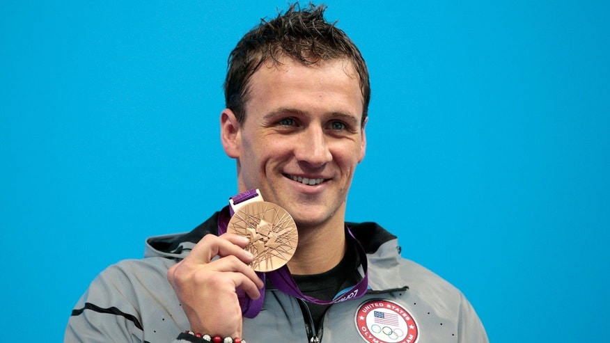 LONDON, ENGLAND - AUGUST 02:  Silver medallist Ryan Lochte of the United States poses on the podium during the medal ceremony  the Men's 200m Individual Medley final on Day 6 of the London 2012 Olympic Games at the Aquatics Centre on August 2, 2012 in London, England.  (Photo by Adam Pretty/Getty Images)