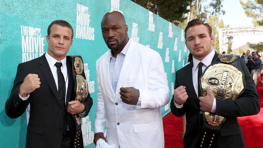 UNIVERSAL CITY, CA - JUNE 03:  Bellator World Champions Pat Curran, King Mo, and Michael Chandler arrive at the 2012 MTV Movie Awards held at Gibson Amphitheatre on June 3, 2012 in Universal City, California.  (Photo by Christopher Polk/Getty Images)