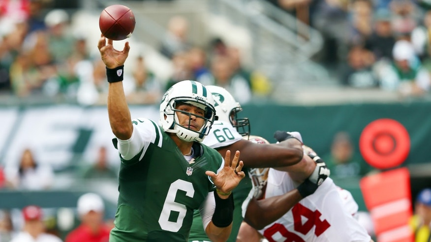 EAST RUTHERFORD, NJ - SEPTEMBER 30:  Mark Sanchez #6 of the New York Jets passes the ball under pressure from Justin Smith #94 of the San Francisco 49ers on September 30, 2012 at MetLife Stadium in East Rutherford, New Jersey.  (Photo by Elsa/Getty Images)