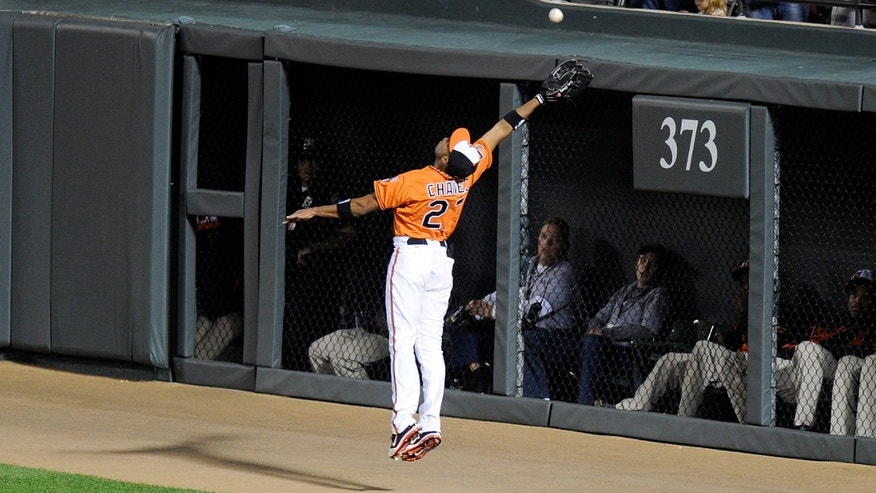 BALTIMORE, MD - SEPTEMBER 24:  Endy Chavez #27 of the Baltimore Orioles makes a catch up against the wall in the first inning against the Toronto Blue Jays at Oriole Park at Camden Yards on September 24, 2012 in Baltimore, Maryland.  (Photo by Greg Fiume/Getty Images)