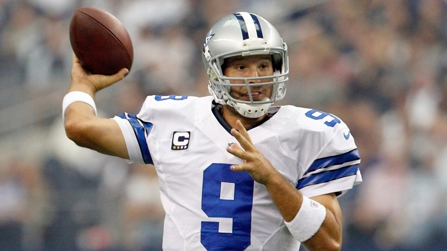 ARLINGTON, TX - SEPTEMBER 23:   Tony Romo, of the Dallas Cowboys, looks for an open receiver against the Tampa Bay Buccaneers at Cowboys Stadium on September 23, 2012 in Arlington, Texas.