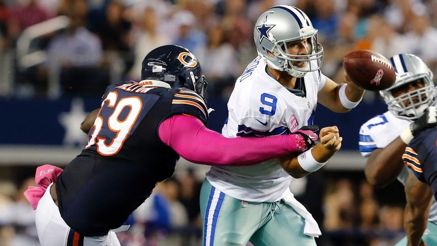 Dallas Cowboys quarterback Tony Romo (9) is sacked by Chicago Bears defensive tackle Henry Melton (69) during the second half ofan NFL football game Monday, Oct. 1, 2012, in Arlington, Texas. The Bears won 34-18. (AP Photo/The Waco Tribune-Herald, Jose Yau)
