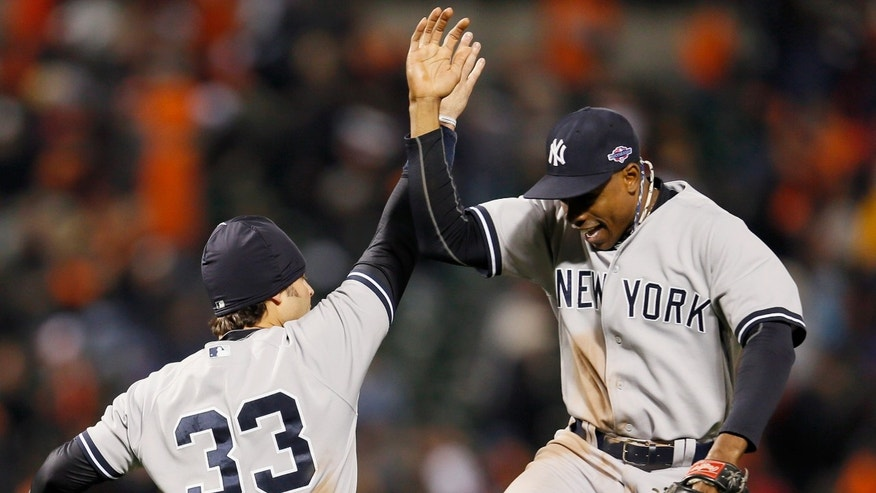 BALTIMORE, MD - OCTOBER 07: Nick Swisher #33 of the New York Yankees and teammate Curtis Granderson #14 celebrate after the Yankees defeated the Baltimore Orioles 7-2 during Game One of the American League Division Series at Oriole Park at Camden Yards on October 7, 2012 in Baltimore, Maryland.  (Photo by Rob Carr/Getty Images)